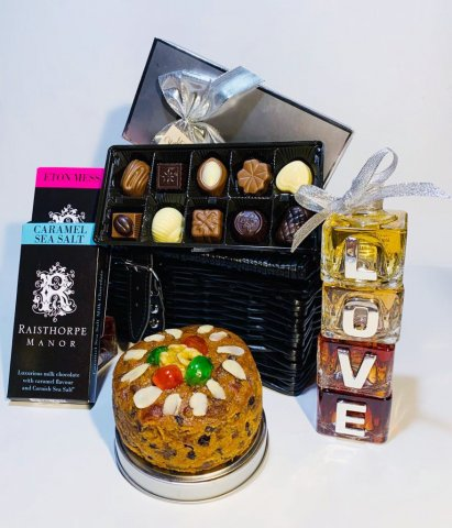 A Celebration of Love Hamper containing Love Gin Cubes, Sloe Port Fruit Cake, Belgian Chocolates, Eton Mess and Caramel Sea Salt Chocolate